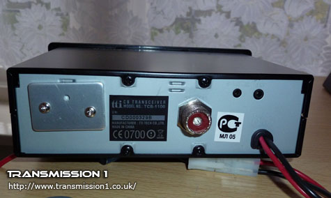 TCB-1100 showing the rear view. Notice the large panel covering up the heatsink area for the high power version of this radio?